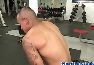 Finelooking fitness hunks banging at the gym