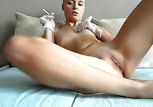 Sophie masturbates with gloves, smokes, than pushes her toys inside her pussy