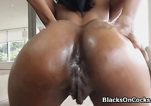 Pounding oiled black booty doggy style