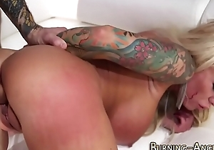 Well-endowed tattoed slut rides